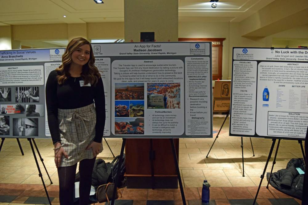 Madison Jacobsen with her research poster